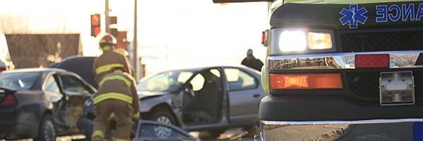 Auto accident and ambulance. Someone may be in need of a Personal Injury Attorney
